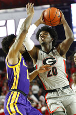 Georgia forward Rayshaun Hammonds (20) lloks to shoot while defended by LSU guard Marlon Taylor (14) during an NCAA college basketball game in Athens, Ga., Saturday, Feb. 16, 2019. (Joshua L. Jones/Athens Banner-Herald via AP)