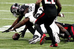 Atlanta Falcons linebacker LaRoy Reynolds (59) recoveres a fumble against the Las Vegas Raiders during the second half of an NFL football game, Sunday, Nov. 29, 2020, in Atlanta. (AP Photo/Brynn Anderson)