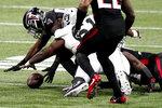 Atlanta Falcons linebacker LaRoy Reynolds (59) recoveres a fumble against the Las Vegas Raiders during the second half of an NFL football game, Sunday, Nov. 29, 2020, in Atlanta. (AP Photo/Brynn Anderson)