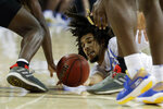 UCLA guard Tyger Campbell dives for a loose ball during the second half of the team's NCAA college basketball game against Washington in Los Angeles, Saturday, Feb. 15, 2020. (AP Photo/Chris Carlson)