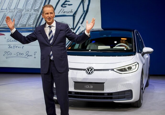 CEO of Volkswagen Herbert Diess introduces the new VW ID.3 at the IAA Auto Show in Frankfurt, Germany, Monday, Sept. 9, 2019. (AP Photo/Michael Probst)