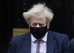 Britain's Prime Boris Johnson leaves 10 Downing Street to attend the weekly Prime Ministers' Questions session in parliament in London, Wednesday, Jan. 13, 2021. (AP Photo/Kirsty Wigglesworth)