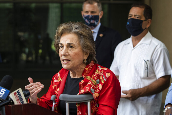 Flanked by other members of the Illinois congressional delegation, U.S. Rep. Jan Schakowsky speaks about the importance of the United States Postal Service during a press conference outside the USPS Chicago Headquarters. (Ashlee Rezin Garcia/Chicago Sun-Times via AP)