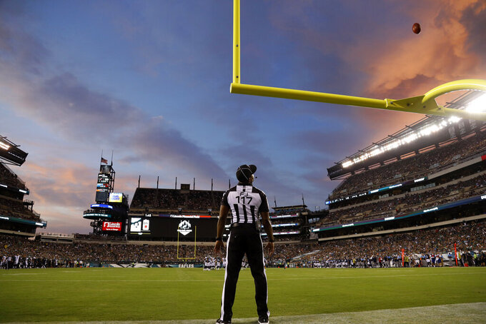 Field judge John Jenkins watches a field goal by Philadelphia Eagles' Jake Elliott during the first half of the team's preseason NFL football game against the Tennessee Titans, Thursday, Aug. 8, 2019, in Philadelphia. (AP Photo/Michael Perez)