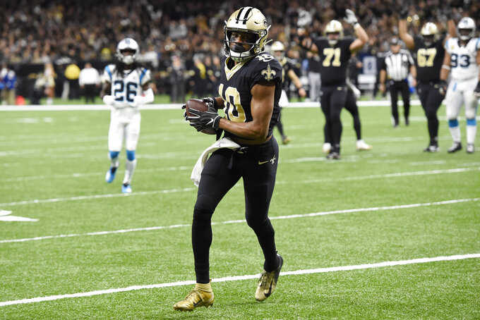New Orleans Saints wide receiver Tre'Quan Smith (10) runs for a touchdown, during the first half at an NFL football game against the Carolina Panthers, Sunday, Nov. 24, 2019, in New Orleans. (AP Photo/Bill Feig)