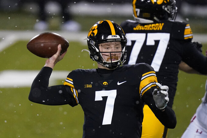 Iowa quarterback Spencer Petras throws a pass during the second half of an NCAA college football game against Wisconsin, Saturday, Dec. 12, 2020, in Iowa City, Iowa. Iowa won 28-7. (AP Photo/Charlie Neibergall)