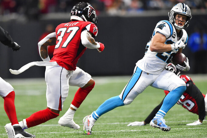 Carolina Panthers wide receiver D.J. Moore (12) runs against Atlanta Falcons free safety Ricardo Allen (37) during the first half of an NFL football game, Sunday, Dec. 8, 2019, in Atlanta. (AP Photo/John Amis)