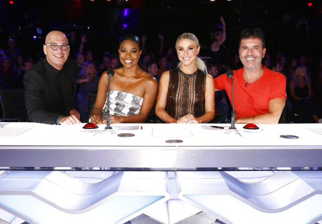 This image released by NBC shows celebrity judges, from left, Howie Mandel, Gabrielle Union, Julianne Hough, Simon Cowell on the set of