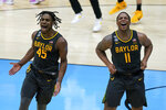 Baylor guard Davion Mitchell (45) and Baylor guard Mark Vital (11) celebrate at the end of the championship game against Gonzaga in the men's Final Four NCAA college basketball tournament, Monday, April 5, 2021, at Lucas Oil Stadium in Indianapolis. Baylor won 86-70. (AP Photo/Darron Cummings)