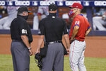 Philadelphia Phillies manager Joe Girardi (25) argues a call with umpires Hunter Wendelstedt (21) and Stu Scheurwater during the first inning of the second game of a baseball doubleheader against the Miami Marlins, Sunday, Sept. 13, 2020, in Miami. (AP Photo/Wilfredo Lee)