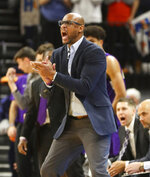 James Madison coach Louis Rowe reacts to a play during the first half of the team's NCAA college basketball game against Virginia in Charlottesville, Va., Sunday, Nov. 10, 2019. (AP Photo/Andrew Shurtleff)