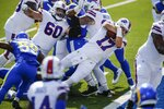 Buffalo Bills quarterback Josh Allen (17) dives into the end zone for a touchdown during the first half of an NFL football game against the Los Angeles Rams Sunday, Aug. 26, 2018, in Orchard Park, N.Y. (AP Photo/John Munson)