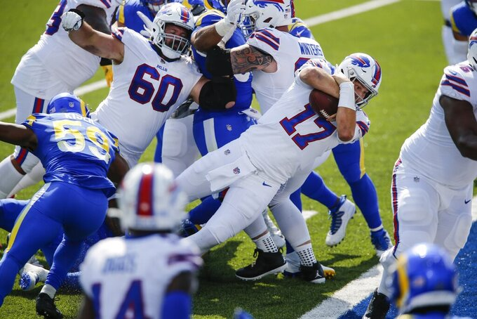 Buffalo Bills quarterback Josh Allen (17) dives into the end zone for a touchdown during the first half of an NFL football game against the Los Angeles Rams Sunday, Sept. 27, 2020, in Orchard Park, N.Y. (AP Photo/John Munson)