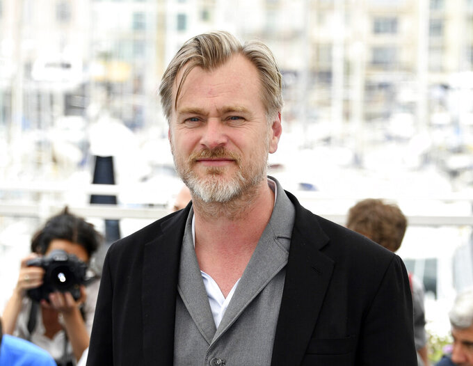 FILE - Director Christopher Nolan poses during a photo call at the 71st international film festival, Cannes, southern France on May 12, 2018. After a public fallout over release strategy with Warner Bros., Nolan's next film, about J. Robert Oppenheimer and the development of the atom bomb, will be released by Universal Pictures. (Photo by Arthur Mola/Invision/AP, File)