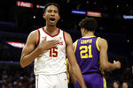 Southern California's Isaiah Mobley (15) celebrates after scoring against LSU during the first half of an NCAA college basketball game Saturday, Dec. 21, 2019, in Los Angeles. (AP Photo/Marcio Jose Sanchez)