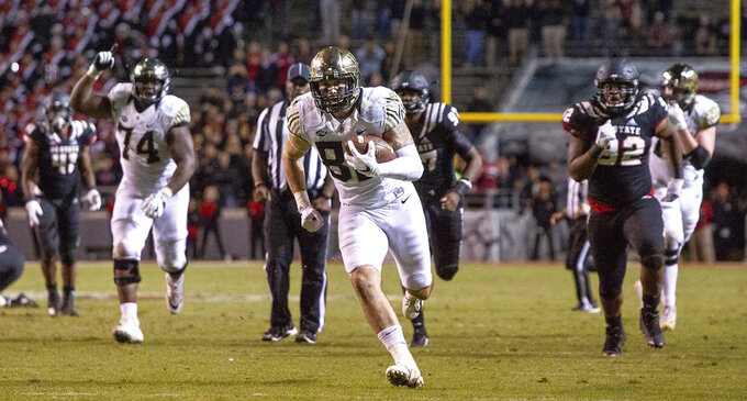 Wake Forest's Jack Freudenthal, middle, breaks free for the game-winning touchdown during the fourth quarter of an NCAA college football game against North Carolina State in Raleigh, N.C., Thursday, Nov. 8, 2018. (AP Photo/Ben McKeown)