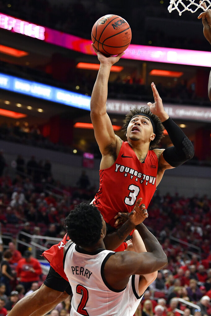 Youngstown State guard Darius Quisenberry (3) attempts to shoot over the defense of Louisville guard Darius Perry (2) during the first half of an NCAA college basketball game in Louisville, Ky., Sunday, Nov. 10, 2019. (AP Photo/Timothy D. Easley)