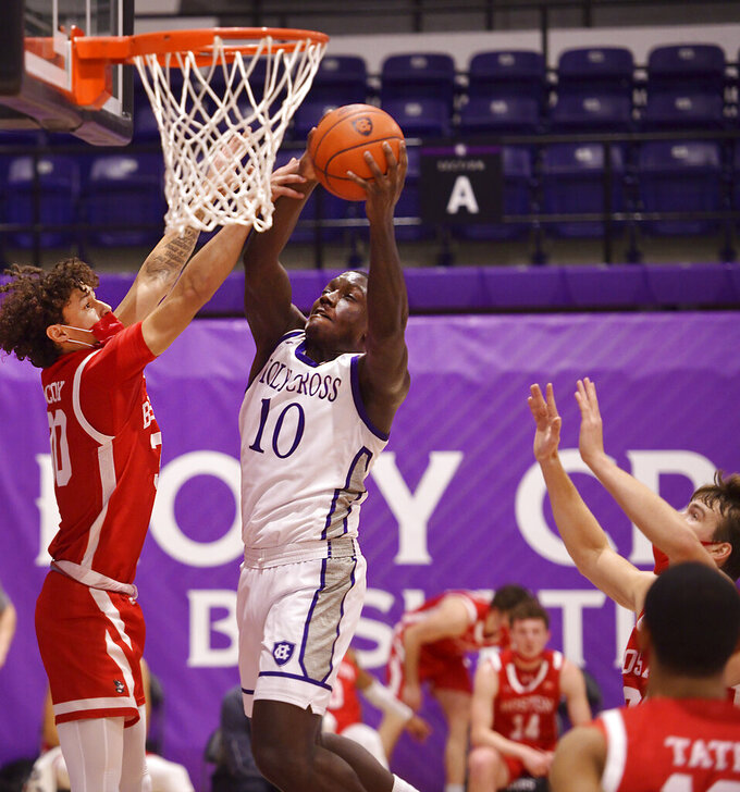 Holy Cross' Gerrale Gates (10) goes for a shot against Boston during an NCAA college basketball game Monday, Jan. 4, 2021, in Worcester, Mass. (Christine Peterson/Worcester Telegram & Gazette via AP)