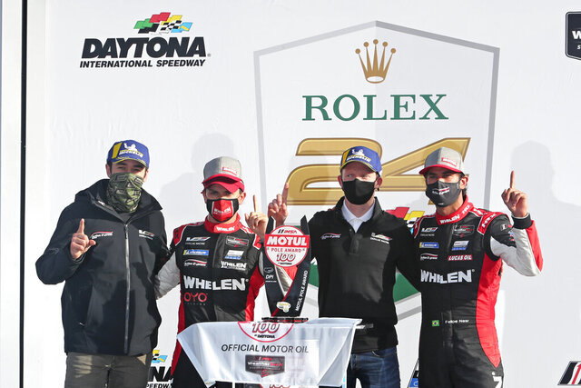 From left to right, Chase Elliot, Pipo Derani, Mike Conway and Felipe Nasr celebrate in Victory Lane after winning a qualifying race for the Rolex 24 hour auto race at Daytona International Speedway, Sunday, Jan. 24, 2021, in Daytona Beach, Fla. The No. 31 Wheelen Engineering Racing Cadillac DPi will have the pole position for the Rolex 24 hour race. (AP Photo/David Graham)