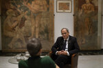 Catalan regional president Quim Torra talks with a journalist at the headquarters of the Government of Catalonia, during an interview with The Associated Press in Barcelona, Spain, Monday, Oct. 21, 2019. The leader of Catalonia says that the massive protests that have often spiralled into violent clashes with police this week won't cease until the Spanish government accepts to listen to separatists' demands. (AP Photo/Emilio Morenatti)