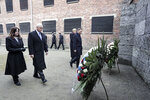 United States Vice President Mike Pence and his wife Karen Pence, left, walk with Poland's President Andrzej Duda and his wife Agata Kornhauser-Duda, right, to wreaths at a death wall during their visit at the Nazi concentration camp Auschwitz-Birkenau in Oswiecim, Poland, Friday, Feb. 15, 2019. (AP Photo/Michael Sohn)