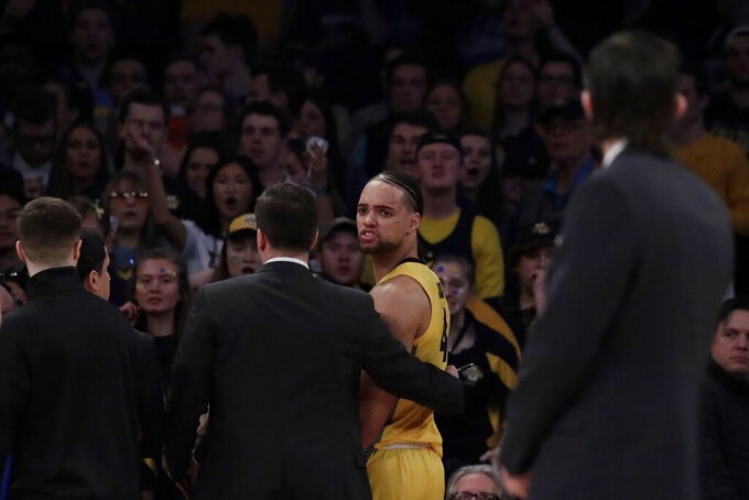 Marquette forward Theo John, center right, reacts after being ejected from an NCAA college basketball semifinal game against Seton Hall in the Big East men's tournament, Friday, March 15, 2019, in New York. Seton Hall won 81-79. (AP Photo/Julio Cortez)