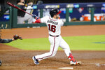 Atlanta Braves' Travis d'Arnaud (16) follows through on a home run during the fourth inning in Game 2 of a baseball National League Division Series against the Miami Marlins Wednesday, Oct. 7, 2020, in Houston. (AP Photo/Eric Gay)