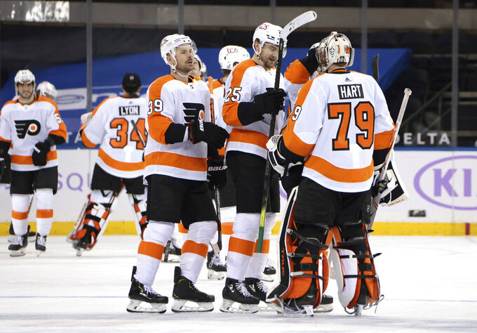 The Philadelphia Flyers celebrate their overtime victory over the New York Rangers in an NHL hockey game at Madison Square Garden, Monday, March 15, 2021, in New York. (Bruce Bennett/Pool Photo via AP)