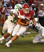Arkansas quarterback Connor Noland is tackled by North Texas defender Brandon Garner in the second half of an NCAA college football game, Saturday, Sept. 15, 2018, in Fayetteville, Ark. (AP Photo/Michael Woods)