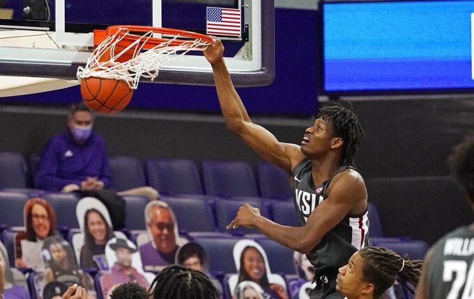 Washington State's Efe Abogidi dunks against Washington in the first half of an NCAA college basketball game Sunday, Jan. 31, 2021, in Seattle. (AP Photo/Elaine Thompson)
