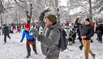 People participate in a snowball fight at Wright Park, Sunday, Feb. 10, 2019, in Tacoma, Wash. Pacific Northwest residents who are more accustomed to rain than snow were digging out from a winter storm and bracing for more on Sunday. (Peter Haley/The News Tribune via AP)