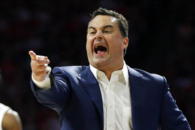 Arizona head coach Sean Miller reacts to a foul call in the first half of an NCAA college basketball game against Gonzaga, Saturday, Dec. 14, 2019, in Tucson, Ariz. (AP Photo/Rick Scuteri)