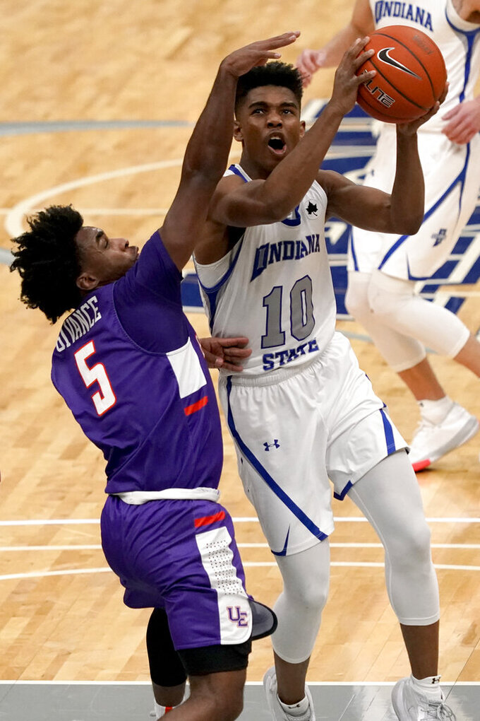 Indiana State's Julian Larry (10) heads to the basket as Evansville's Shamar Givance (5) defends during the second half of an NCAA college basketball game in the quarterfinal round of the Missouri Valley Conference men's tournament Friday, March 5, 2021, in St. Louis. (AP Photo/Jeff Roberson)