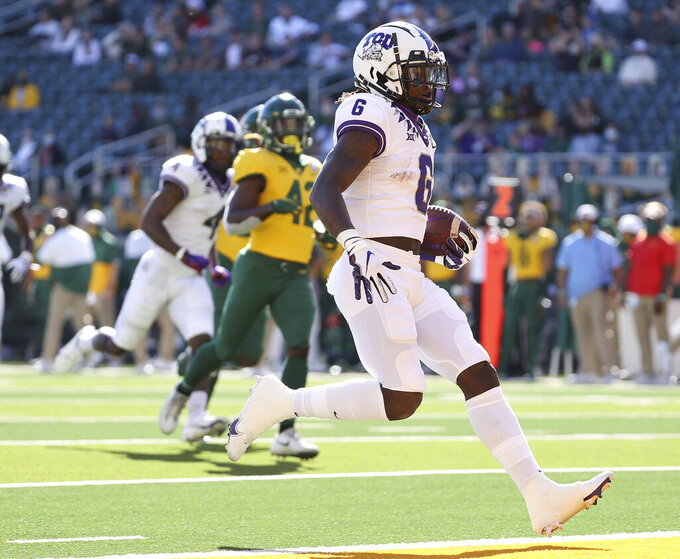 TCU running back Zach Evans (6) scores a touchdown against Baylor duirng the first half of an NCAA college football game in Waco, Texas, Saturday, Oct. 31, 2020. (Jerry Larson/Waco Tribune-Herald via AP)