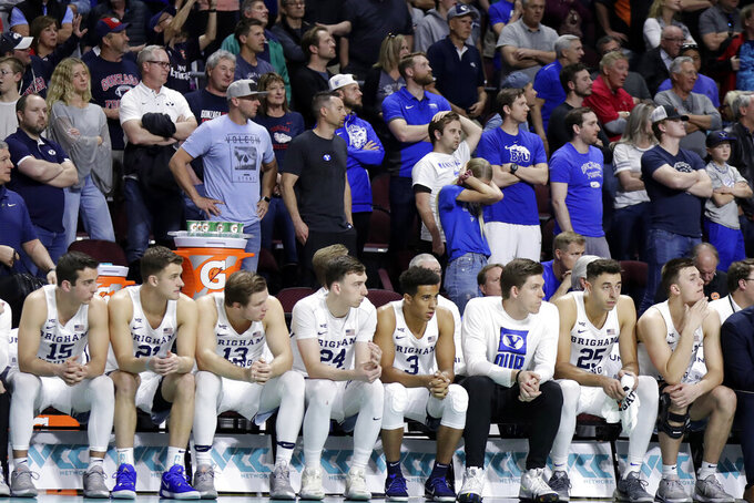 BYU's bench watches during the final moments of the second half of an NCAA college basketball game against Saint Mary's in the West Coast Conference tournament, Monday, March 9, 2020, in Las Vegas. Saint Mary's won 51-50. (AP Photo/Isaac Brekken)