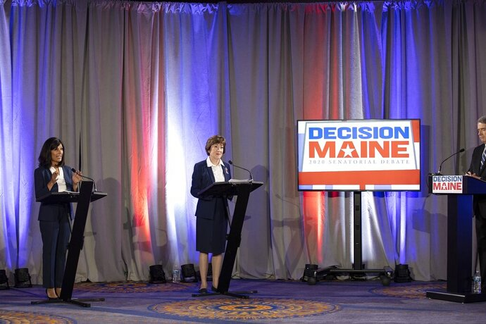 Sen. Susan Collins and Maine House Speaker Sara Gideon participate in the debate at the Holiday Inn By The Bay, Friday, Sept. 11, 2020 in Portland, Maine.  (Brianna Soukup/Portland Press Herald via AP)