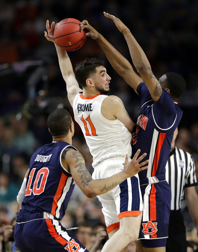 Auburn's Horace Spencer (0) blocks a shot by Virginia's Ty Jerome (11) during the second half in the semifinals of the Final Four NCAA college basketball tournament, Saturday, April 6, 2019, in Minneapolis. (AP Photo/Jeff Roberson)