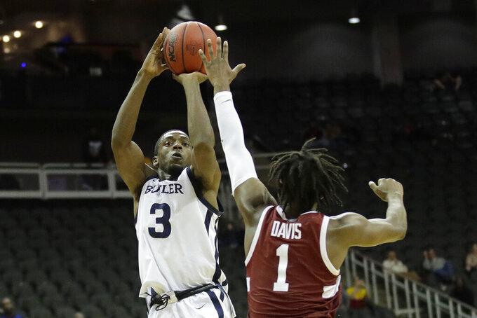 Butler guard Kamar Baldwin (3) shoots over Stanford guard Daejon Davis (1) to score the winning basket during an NCAA college basketball game Tuesday, Nov. 26, 2019, in Kansas City, Mo. Butler won 68-67. (AP Photo/Charlie Riedel)