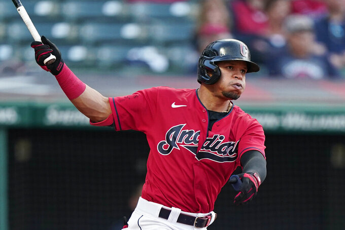Cleveland Indians' Cesar Hernandez watches his two-run home run in the 10th inning of a baseball game against the Minnesota Twins, Saturday, May 22, 2021, in Cleveland. (AP Photo/Tony Dejak)