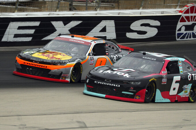 Noah Gragson (9) passes Ross Chastain (6) coming out of Turn 4 during a NASCAR Xfinity Series auto race at Texas Motor Speedway in Fort Worth, Texas, Saturday, Oct. 24, 2020. (AP Photo/Richard W. Rodriguez)