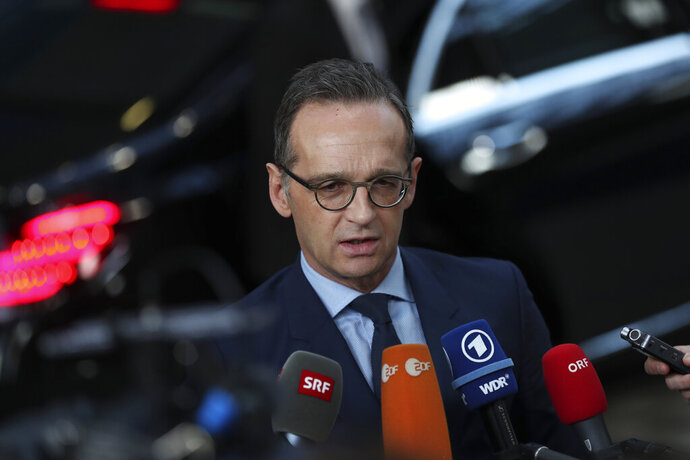 Germany's Foreign Minister Heiko Maas speaks with the media as he arrives to an EU Foreign Ministers meeting at the European Council headquarters in Brussels, Monday, Feb. 18, 2019. US President Donald Trump's demand that European countries take back their nationals fighting in Syria is receiving mixed reactions, as nations pondered how to bring home-grown Islamic State extremists to trial. (AP Photo/Francisco Seco)