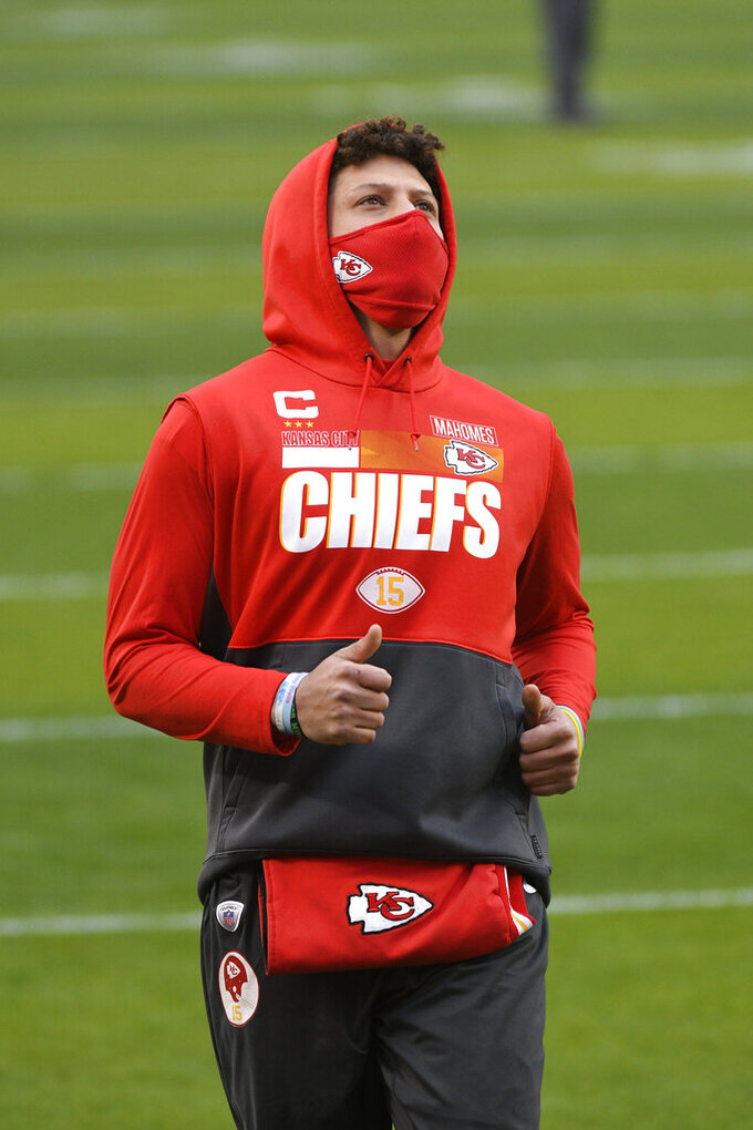 Kansas City Chiefs quarterback Patrick Mahomes runs on the field before the AFC championship NFL football game against the Buffalo Bills, Sunday, Jan. 24, 2021, in Kansas City, Mo. (AP Photo/Reed Hoffmann)