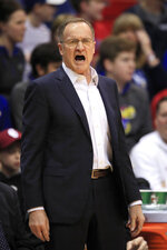 Oklahoma head coach Lon Kruger yells to his team during the first half of an NCAA college basketball game against Kansas in Lawrence, Kan., Saturday, Feb. 15, 2020. (AP Photo/Orlin Wagner)