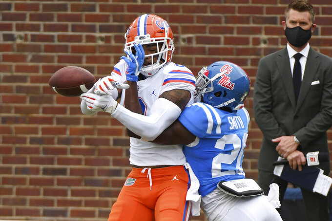 Mississippi defensive back A.J. Finley (21) breaks up a pass intended for Florida wide receiver Trevon Grimes (8) during the first half of an NCAA college football game in Oxford, Miss., Saturday, Sept. 26, 2020. (AP Photo/Thomas Graning)