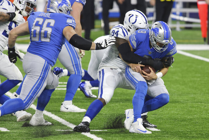 Indianapolis Colts defensive end Tyquan Lewis (94) sacks Detroit Lions quarterback Matthew Stafford (9) during the first half of an NFL football game, Sunday, Nov. 1, 2020, in Detroit. (AP Photo/Tony Ding)