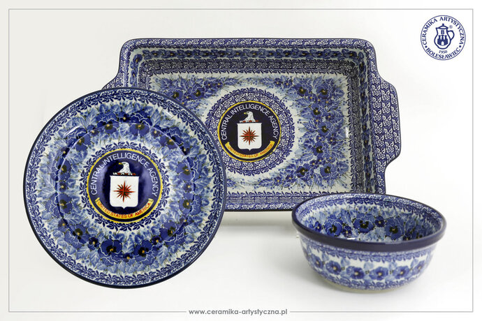 In this undated photo made available on Friday, Aug. 10, 2018 by the Boleslawiec Artistic Handicrafts Cooperative,  pieces of unique hand-painted pottery with the CIA logo recently made for the U.S. intelligence agency by the renowned Polish stoneware cooperative.  It was secret handiwork done for the CIA by experts in Poland: painted tableware with the intelligence agency's logo. Helena Smolenska, the head of the cooperative in Boleslawiec, in southern Poland, which made the unique set, said the hardest bit was to get the CIA logo on the pottery to be the right design and the right color to match the set's blue floral design. (Boleslawiec Artistic Handicrafts Cooperative via AP)