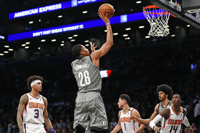 Brooklyn Nets guard Spencer Dinwiddie (26) goes up for a shot during the second quarter of an NBA basketball game against the Phoenix Suns, Monday, Feb. 3, 2020, in New York. (AP Photo/Kathy Willens)