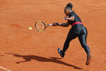 "FILE - In this May 29, 2018, file photo, Serena Williams, of the United States, returns a shot against Krystyna Pliskova, of the Czech Republic, during their first round match of the French Open tennis tournament at the Roland Garros stadium in Paris. French tennis authorities said her daring, full-length catsuit would no longer be welcome at the French Open. Rising to her defense were not so much the editors of Vogue but Mahmoud Ahmadinejad, the former president of Iran. He tweeted that the French were ""disrespecting"" Williams. (AP Photo/Michel Euler, File)"