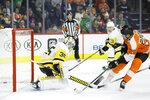Philadelphia Flyers' James van Riemsdyk, right, scores a goal past Pittsburgh Penguins' Tristan Jarry during the second period of an NHL hockey game, Tuesday, Jan. 21, 2020, in Philadelphia. (AP Photo/Matt Slocum)