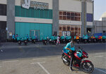 Delivery drivers for the app Deliveroo wait for orders, in Dubai, United Arab Emirates, Thursday, Sept. 9, 2021. Advocates and workers say that casualties among food delivery riders are mounting in the city of Dubai, as the pandemic accelerates a boom in customer demand. The trend has transformed Dubai's streets and drawn thousands of desperate riders, predominantly Pakistanis, into the high-risk, lightly regulated and sometimes-fatal work. (AP Photo/Jon Gambrell)